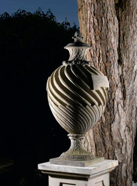 A-composition-stone-lidded-Pope-urn-on-pedestal