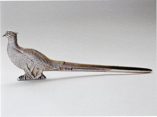 A-fine-cast-double-sided-paper-knife-or-letter-opener-realistically-chased-as-a-pheasant standing amogst foliage by Richard Comyns 1959