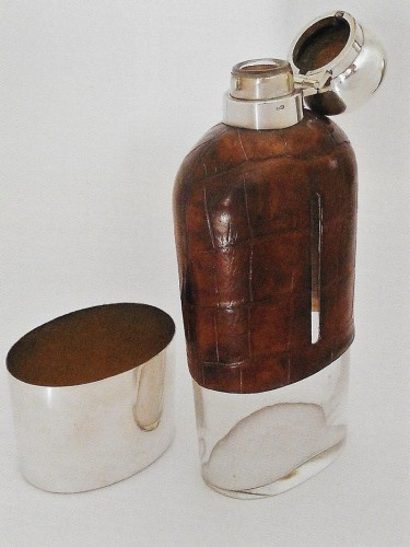 A-large-Victorian-flask-the-glass-body-partly-covered-in-crocodile-and-with-plated-mounts by Dixon and Sons sheffield 1895