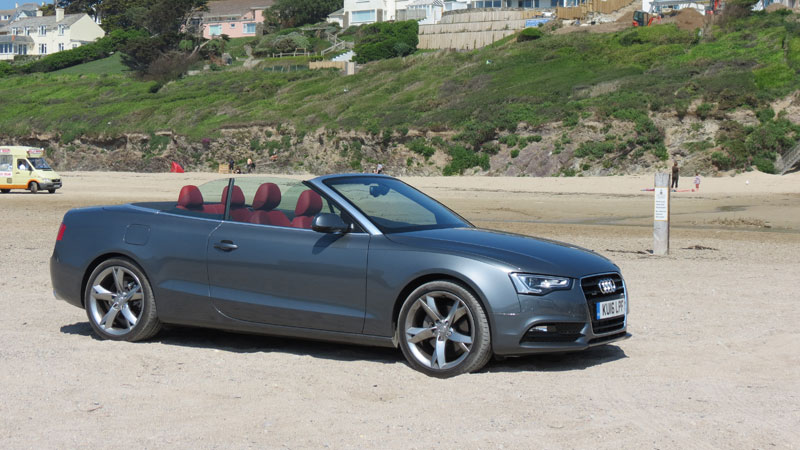 Audi A5 Cabriolet 2.0 TFSI quattro SE 230 PS S Tronic on Polzeath Beach Cornwall still chasing Mr. Whippy