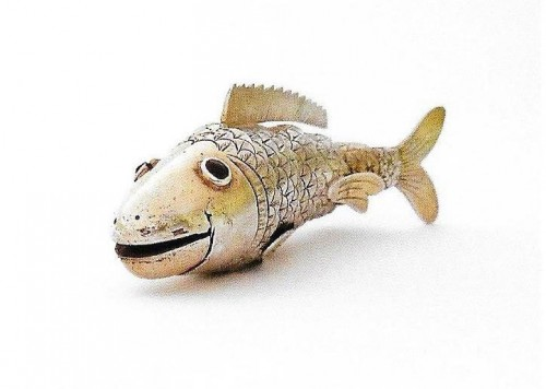 Late 19th century Chinese articulated fish partly gilt with red glass eyes