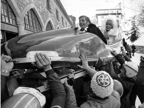 Gunter-Sachs-and-friend-being-hoisted-aloft-in-a-bobsleigh