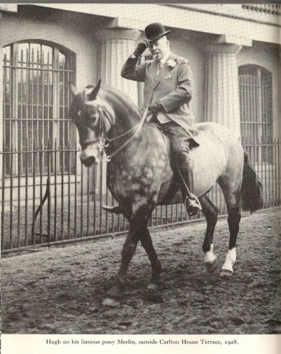Hugh Lowther on horseback with cigar