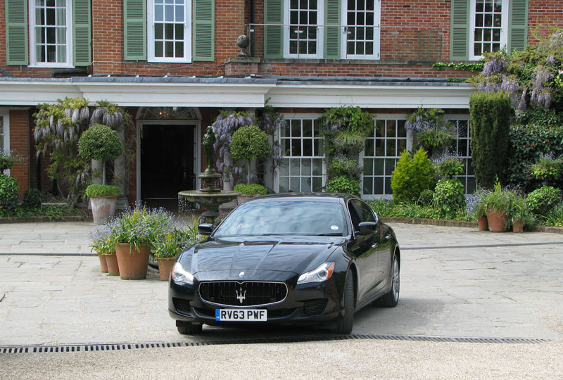 Maserati Quattroporte in front of Chewton Glen