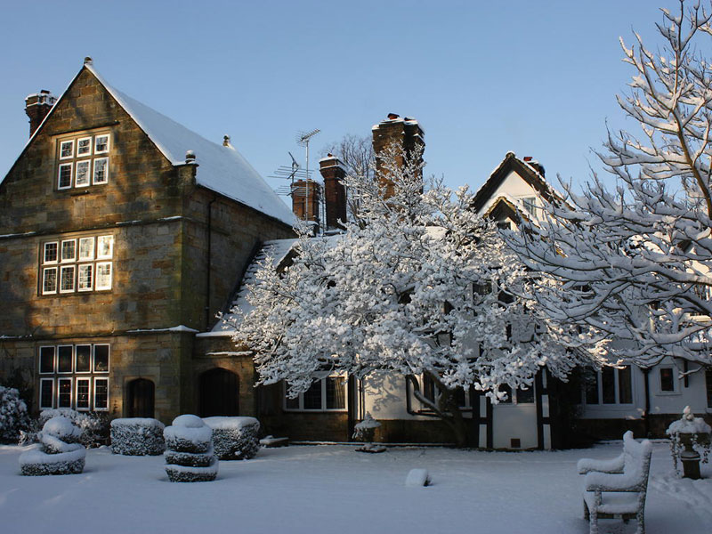 Ockenden Manor looking impossibly beautiful in  a winter covering of snow
