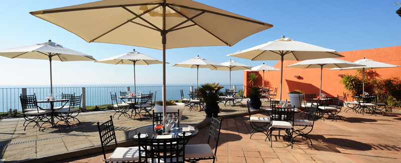 Pebble Beach terrace Barton on sea in sunshine