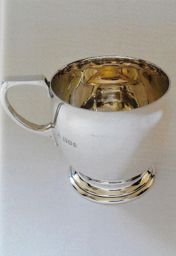 Silver George V mug of bulbous form applied with gold fish by Wakeley & Wheeler 1929