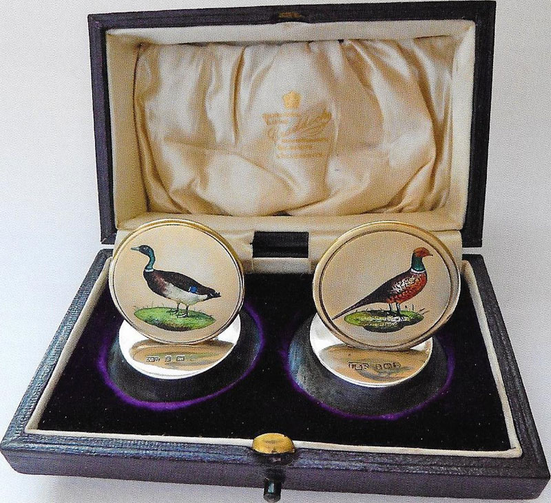 Two Edwardian beautifully painted enamelled place card holders depicting a cock pheasant and mallard drake by Levi and Salomon of Birmingham 1908