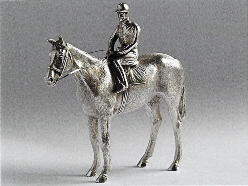 A Rare Victorian cast Pepper modelled as a jockey, probably Fred Archer on horseback by William and John Barnard 1882