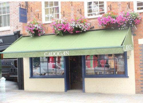 exterior of Cadogan & Co with summer hanging baskets