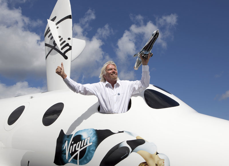 Sir Richard Branson in Spaceshiptwo Holding Model of Launcherone