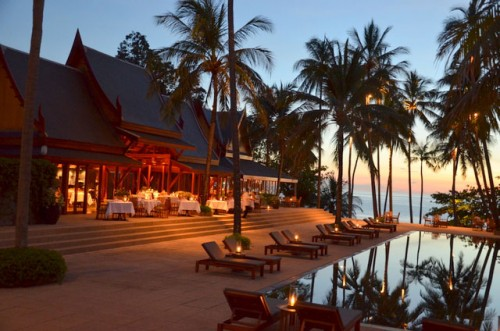 The Amanpuri - the pool and restaurant at dusk